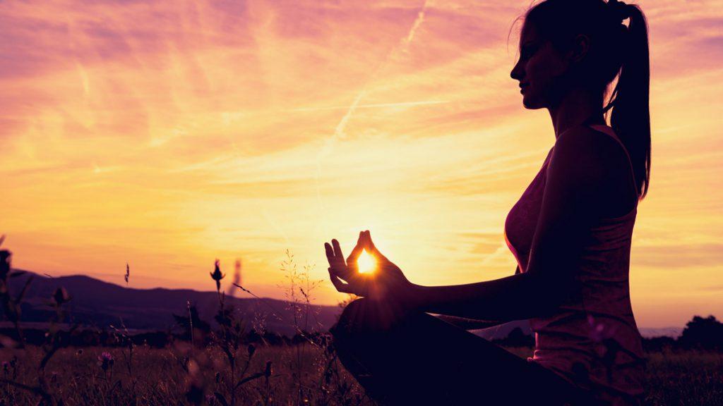 Woman practicing Atma Kriya Yoga in Dublin